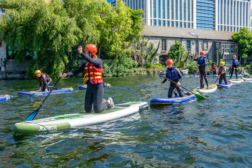 Kids summer camp stand up paddle boarding at Surfdock Dublin in grand canal dock
