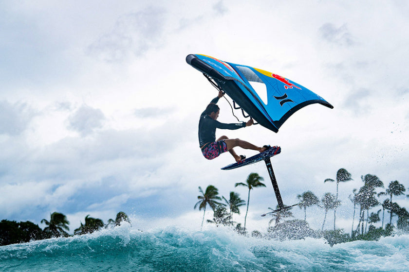 Red Bull Team rider, Kai Lenny getting air while wing foiling in the tropics