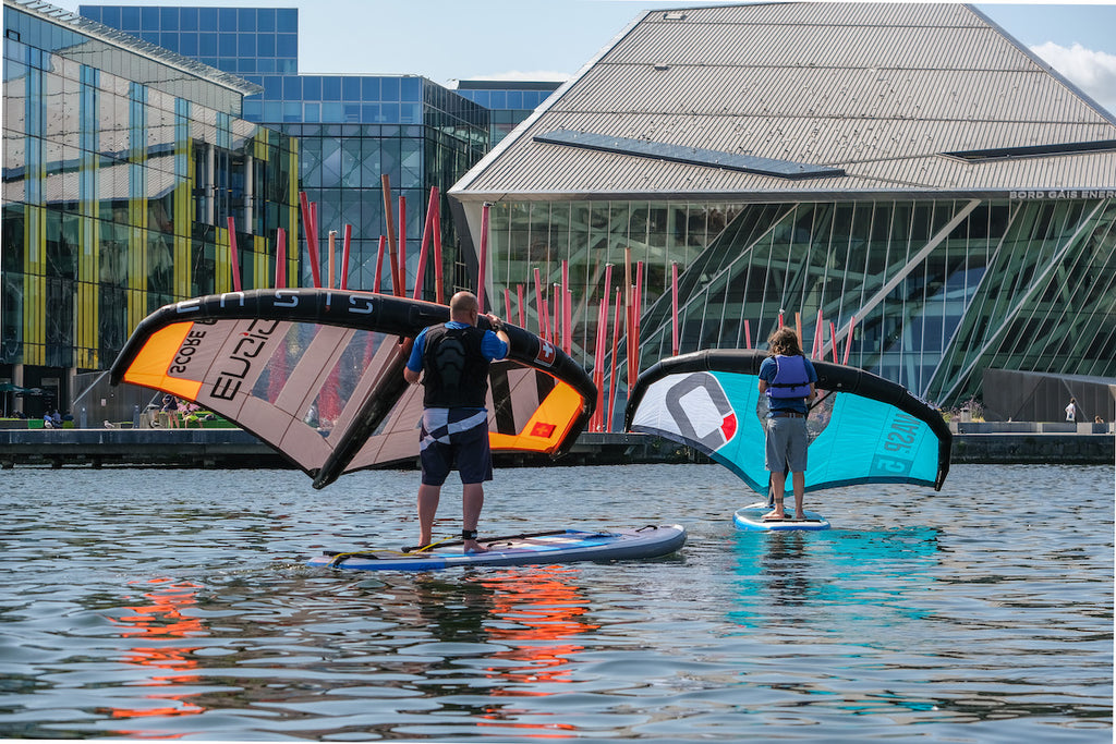 2 guys wingsurfing in Stand Up Paddle Boards at Surfdock in Grand Canal Dock Dublin