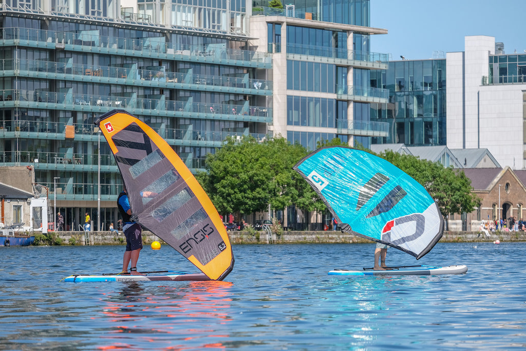 A couple of people learning to wingsurf at Surfdock in grand canal dock Dublin.