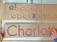 metallic chickpea pearls in use with a wooden name board