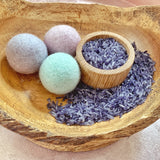 Calm down kit includes 3 large pastel felt balls and lavender scented rice displayed in the photo in a wooden bowl
