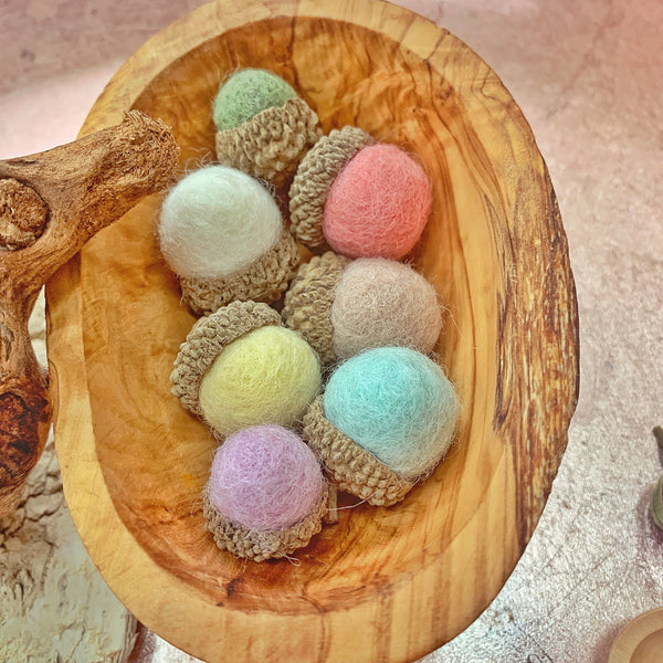 pastel felt acorns made with felt balls and natural acorn caps for loose parts