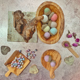 pastel felt acorns made with felt balls and natural acorn caps for loose parts  displayed on a play tray