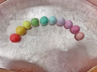 pastel rainbow felt balls 20mm in an arch