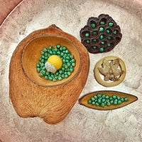 coconut treasure basket with  giant felt acorn and metallic green chick peas