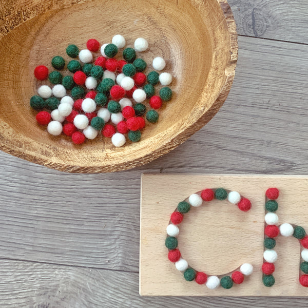 xmas mini felt balls on wooden name board