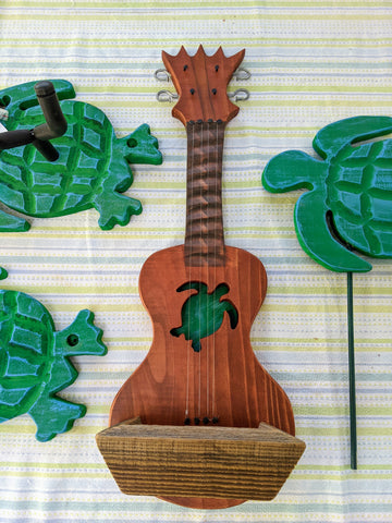Ukulele with a green and blue sea turtle cut into it