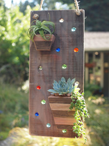 Reclaimed wood hanging planter with colorful marbles