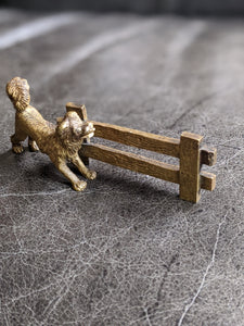 Miniature Brass Dog at a Fence