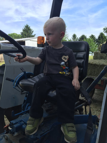 Little future farmer grandson Silas wanting to drive the tractor