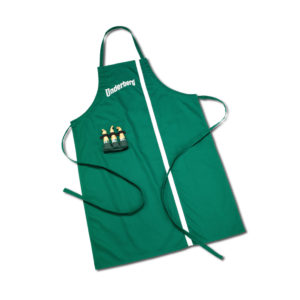 Green cooking apron embroidered with the Underberg logo with three loops containing Underberg bottles