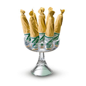 A goblet-shaped clear crystal glass stand holding six bottles of Underberg