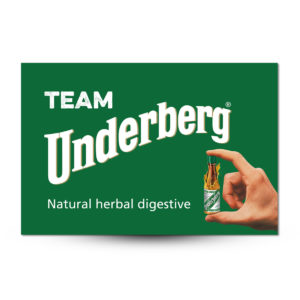 """Green flag showing a hand holding a bottle of Underberg and the text """"Team Underberg Natural Herbal Digestive"""""""