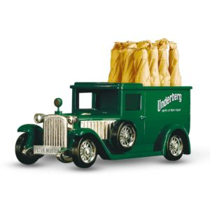 Small green old-fashioned car toy with six bottles of Underberg in the trunk