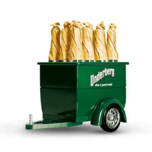 Small green toy truck trailer with Underberg logo and six bottles