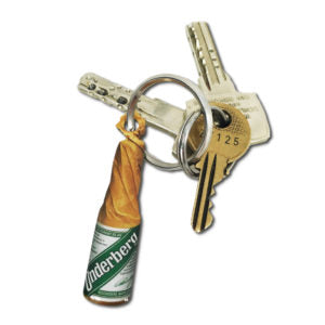 A small key chain shaped like the traditional Underberg bottle