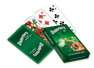 Set of old-fashioned Skatspiel playing cards in green Underberg-themed box