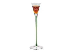 A small cone-shaped glass with a long green stem and custom engraving filled with Underberg