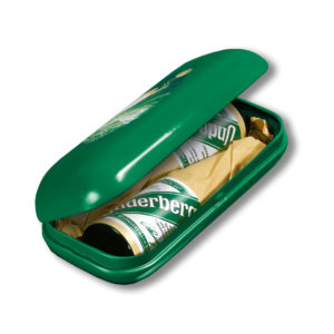A green oval-shaped tin that holds two bottles of Underberg