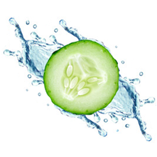 A green slice of cucumber in front of splashing water