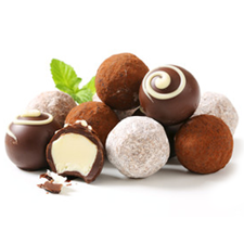 A pile of assorted round chocolate truffles