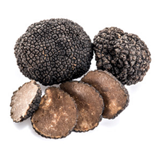 Dark brown truffles with four slices