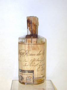 A bottle of 4711 from the 19th century covered in old-fashioned cursive writing