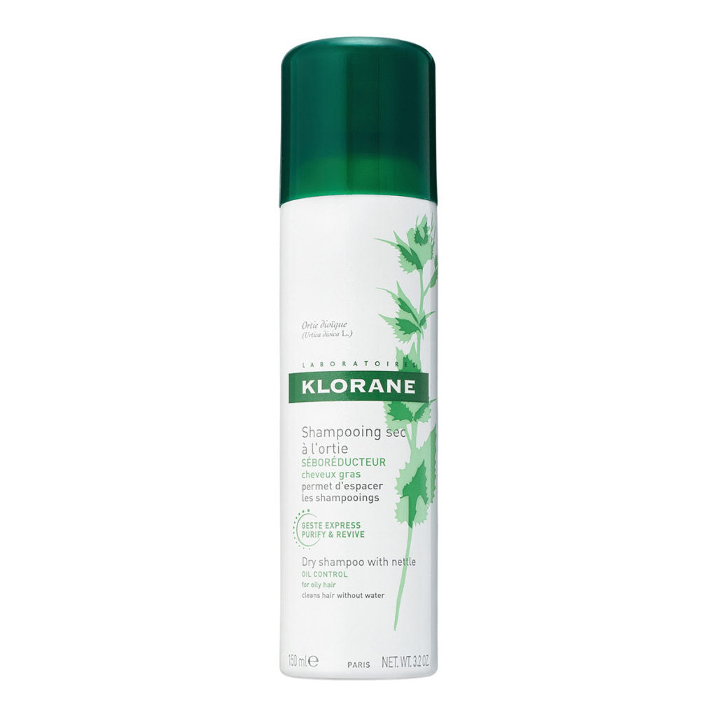 Spray bottle of Klorane Dry Shampoo with green cap