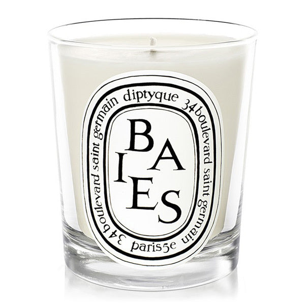 A white Diptyque Baies candle with a white oval logo