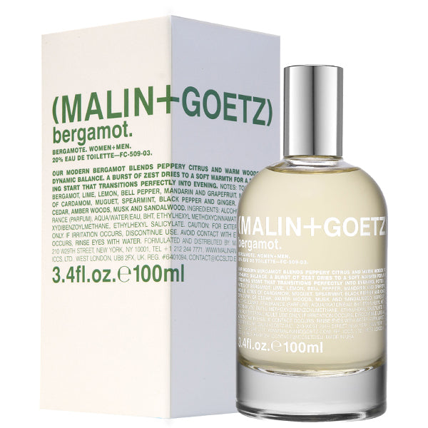 A white box with green text and the Malin and Goetz logo next to an off-white bottle of Bergamot Eau de Parfum