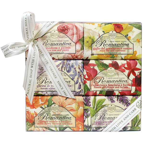 Six Nesti Dante soaps wrapped in decorative floral papers and tied together with a white ribbon