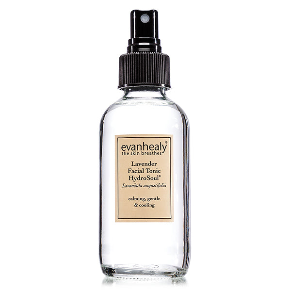 A clear bottle with a tan label of evanhealy lavender hydrosol with a spray applicator