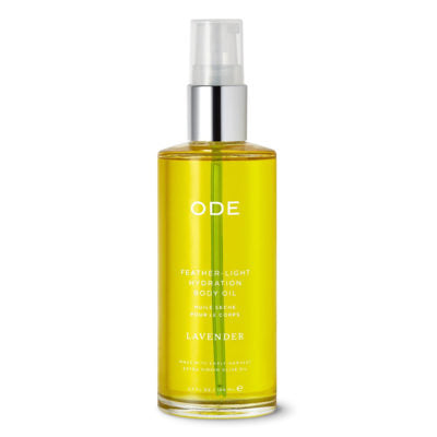 A clear bottle of ODE lavender body oil with a pump dispenser