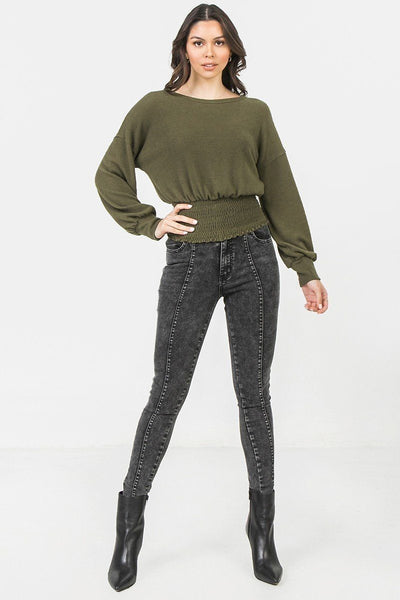 A Knit Top Featuring Wide Neckline