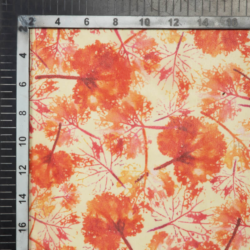 Cream And Orange Leaf Pattern Digital Print Muslin Fabric