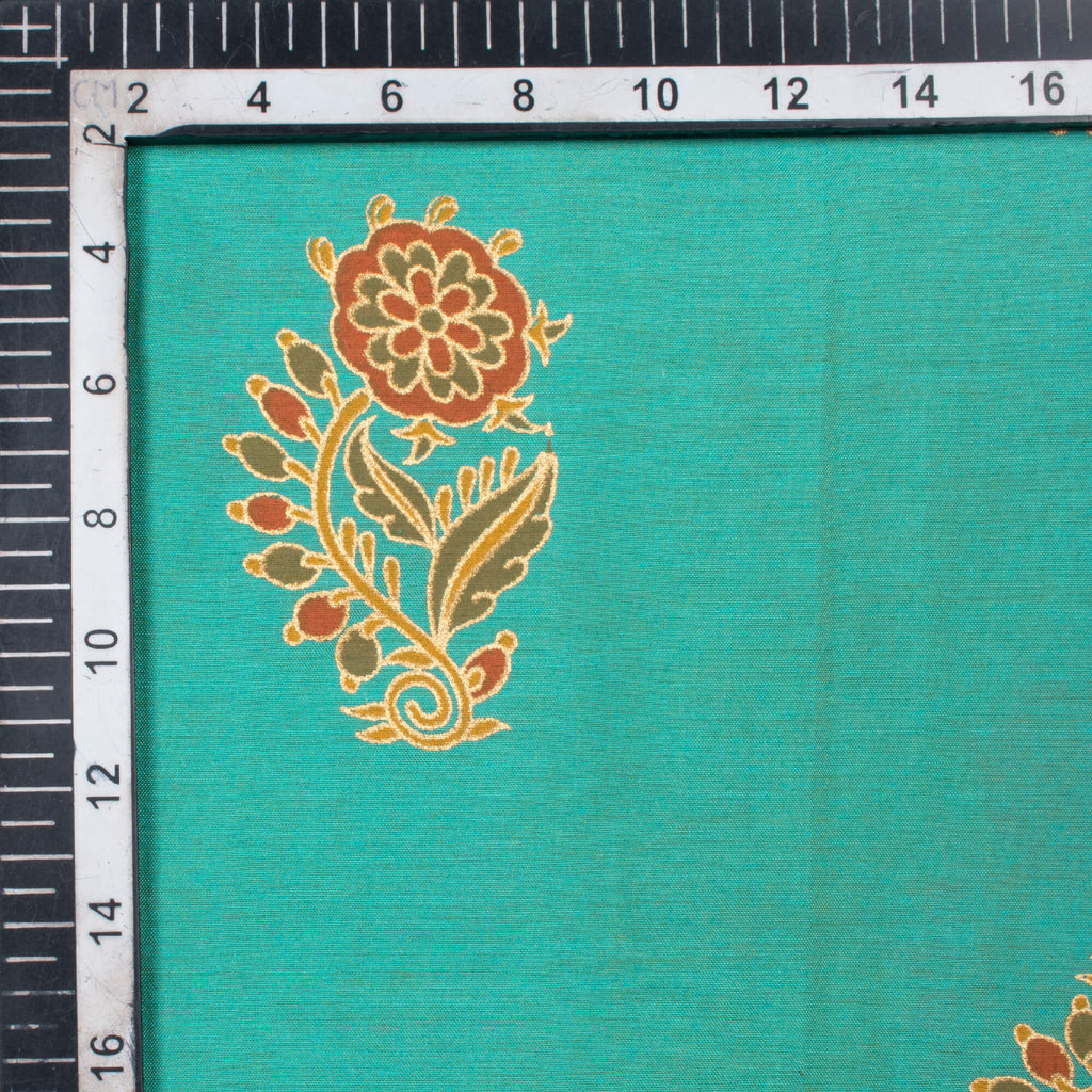 Turquoise And Orange Floral Pattern Foil Print Dual Tone Muslin Fabric - Fabcurate