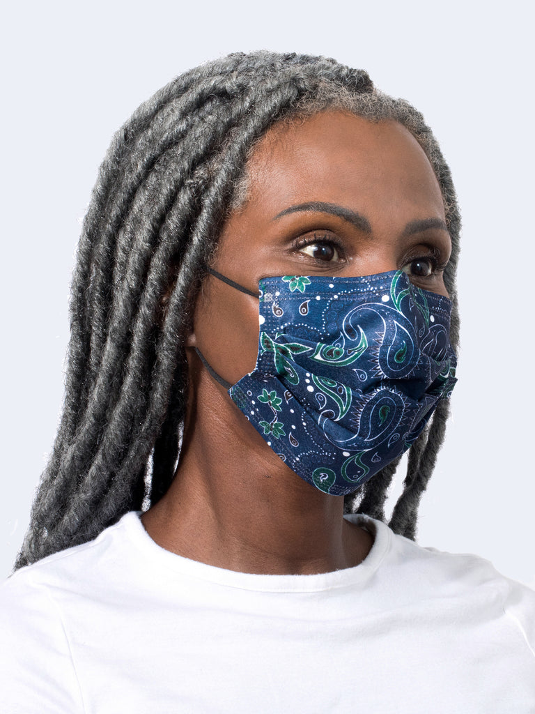 barrière bandana print medical mask in navy, green, white, and black on a model's face