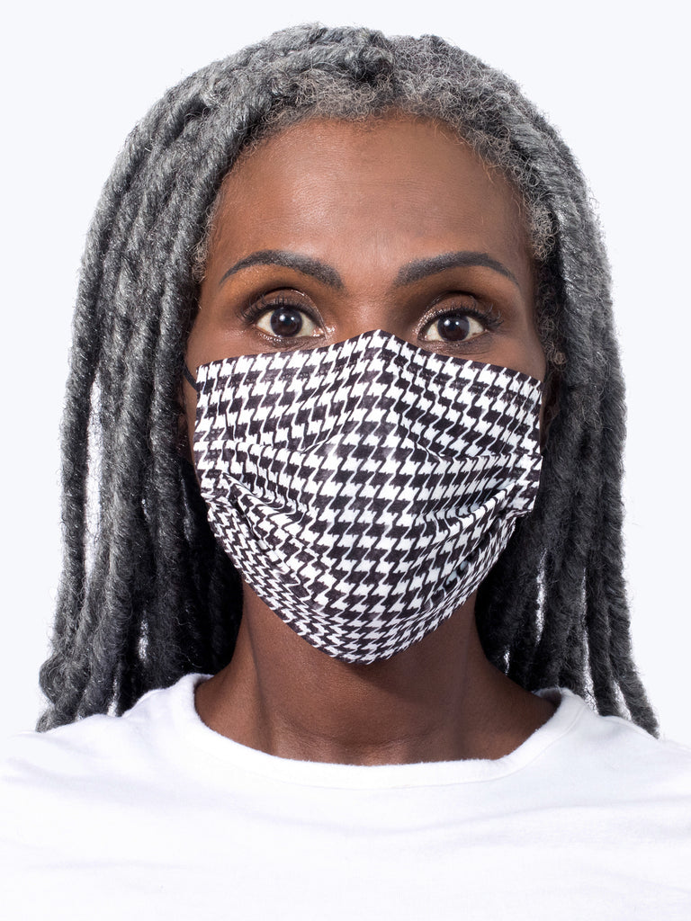 barrière black and white houndstooth print medical mask on model's face