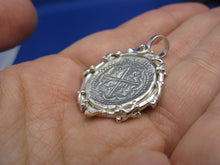 "Load image into Gallery viewer, Sterling Silver Graveyard Skeleton Bone Wrapped Bezel with Reproduction ""1 Reale"" Pirate Treasure Coin Cob Necklace (Shipwreck Jewelry)"