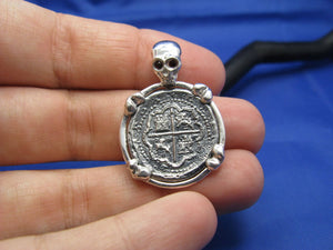"Sterling Silver Pirate Coin Pendant with Reproduction ""1 Reale"" Treasure Cob with Red Crysta Skull Bail and Bone Prongs"