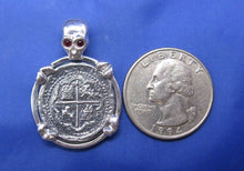 "Load image into Gallery viewer, Sterling Silver Pirate Coin Pendant with Reproduction ""1 Reale"" Treasure Cob with Red Crysta Skull Bail and Bone Prongs"
