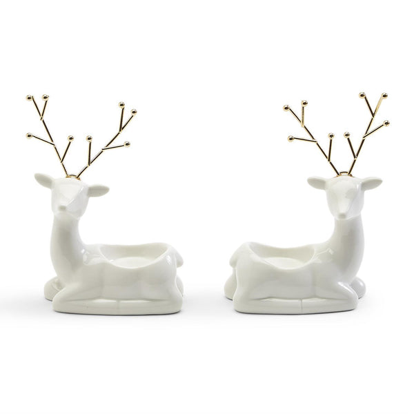 white porcelain reindeer with gold antlers hold one tealight candle
