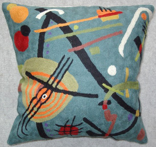 Pillow, multi-color, geometric shapes, blue background color, cotton canvas shell with hand sewn wool thread.