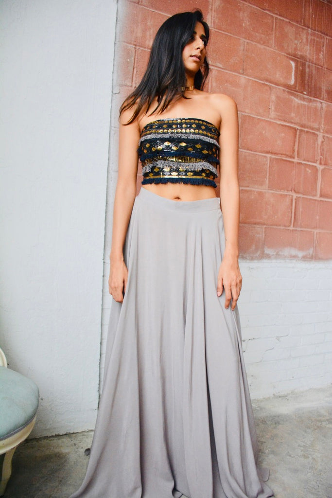 Gray crepe silk skirt paired with a gray/navy/black/gold embellished corset blouse