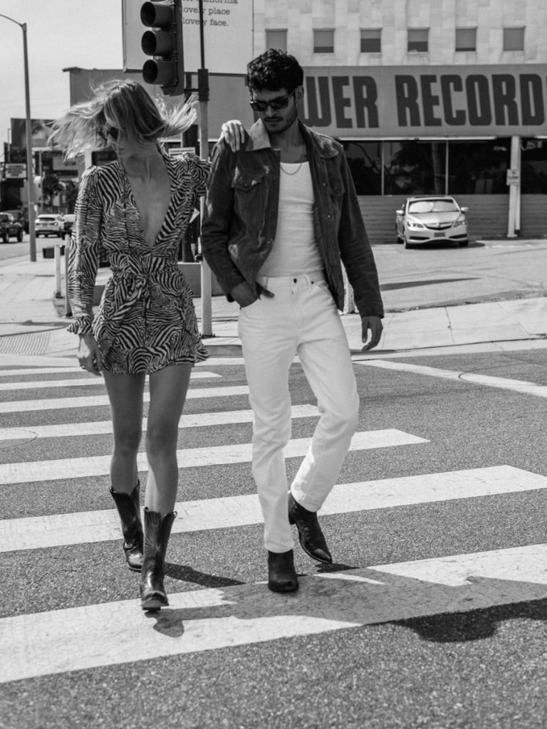 Stylish couple just passing Tower Records on Sunset Blvd wearing vintage cowboy boots.