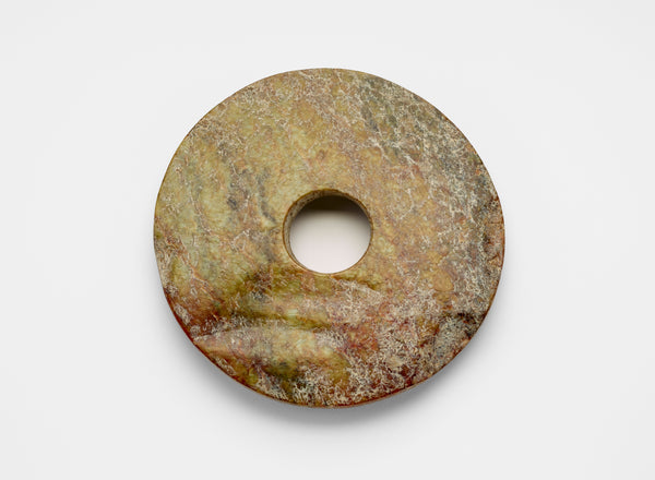 Nephrite jade bi, late Neolithic period, ca. 3300-2250 BCE. (Freer Gallery of Art)