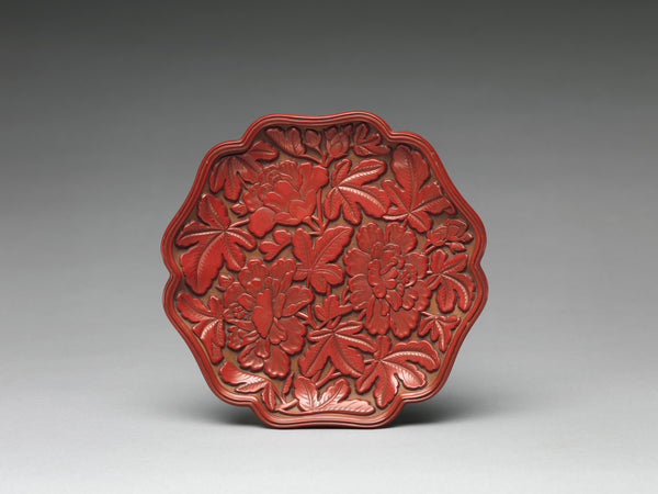 A dish of carved red (cinnabar) lacquer from the Yuan dynasty (1271–1368).  (Metropolitan Museum of Art)