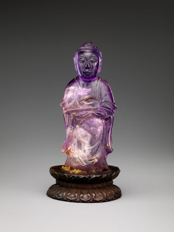 Standing Buddha carved of amethystine quartz, Qing dynasty (1644–1911), China. (Metropolitan Museum of Art)