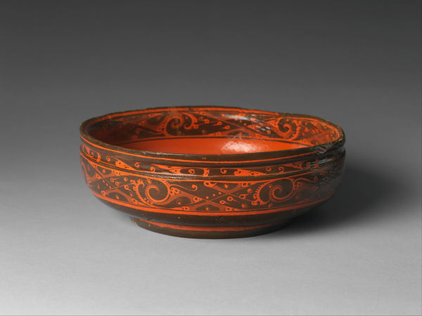 A bowl of black lacquer painted with red lacquer from the Western Han dynasty (206 B.C.–A.D. 9). (Metropolitan Museum of Art)